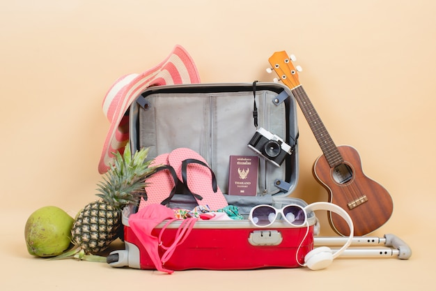 Suitcase with traveler accessories Free Photo