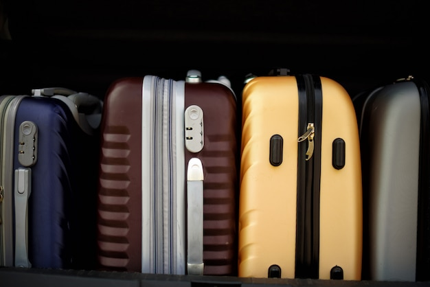 Suitcases and bags in car trunk. Premium Photo