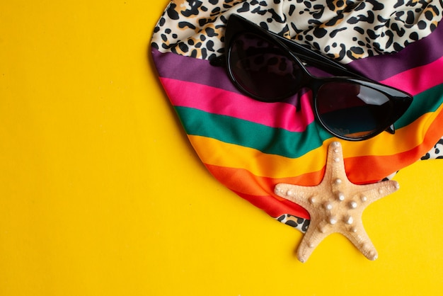 Summer accessories, shells, scarf and sun glasses. summer vacation and sea concept. Premium Photo