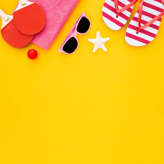 Summer accessories on yellow Free Photo