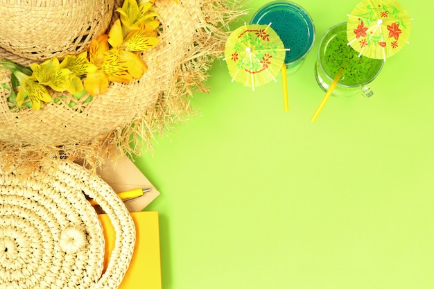 Summer banner with straw hat, bag and cocktails Premium Photo