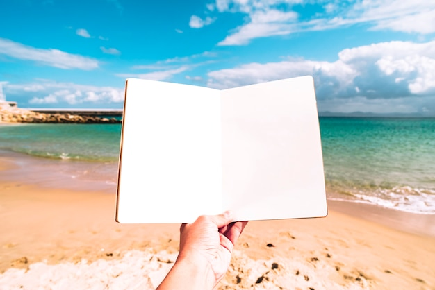 Summer beach background with a blank notebook Free Photo