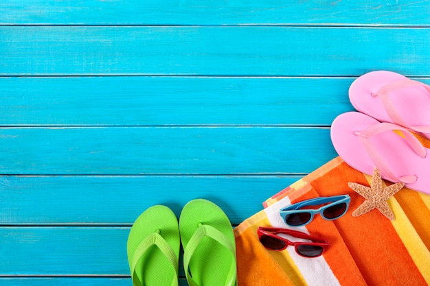 67408b37af79 Summer beach background with flip flops Free Photo