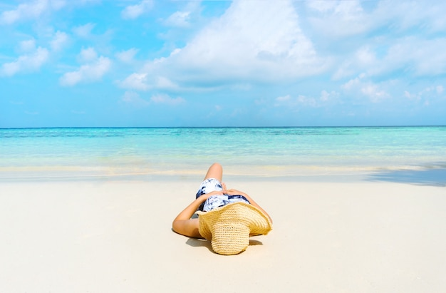 Summer beach holiday woman relax on the beach in free time . Premium Photo