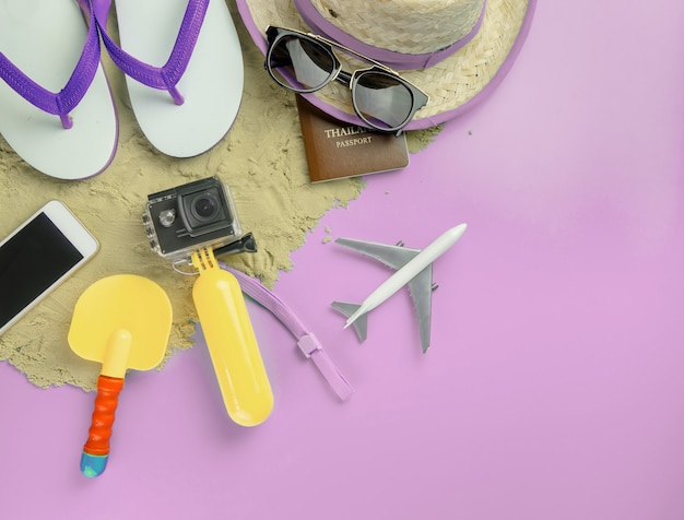 Summer beach island travel fashion gadgets and toys on pink copy space Premium Photo