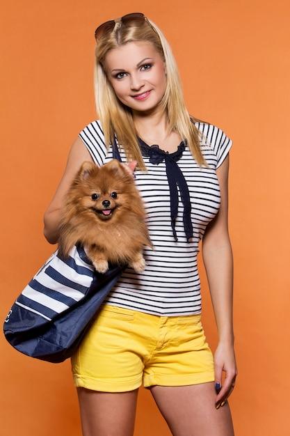 Summer. beautiful blonde with dog Free Photo