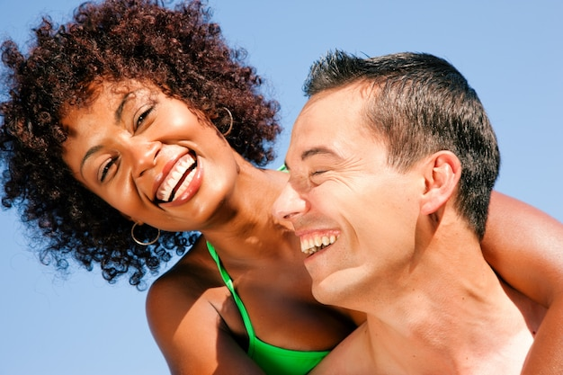 Summer bikini girl with boyfriend Premium Photo