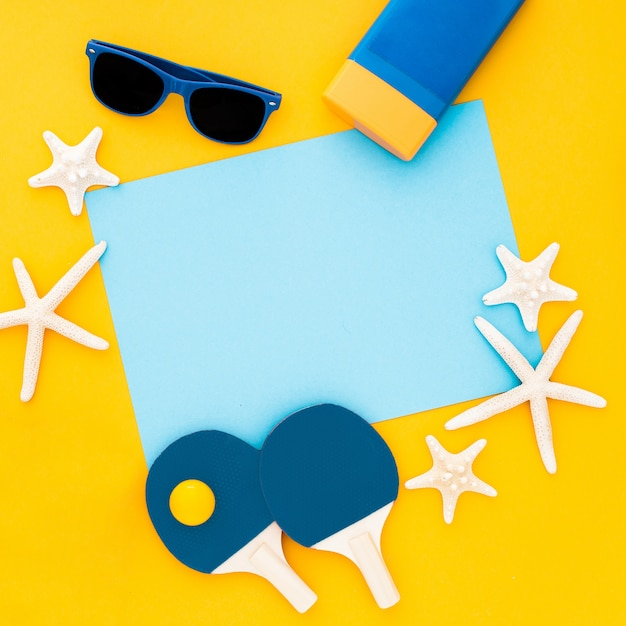 Summer composition. starfishes, sunglasses, blue empty frame on pastel yellow Free Photo