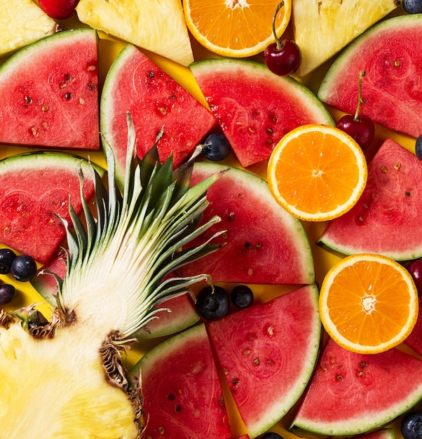 pineapple and watermelon background. tasty appetizing slice of pineapple with watermelon slices on yellow bright and background