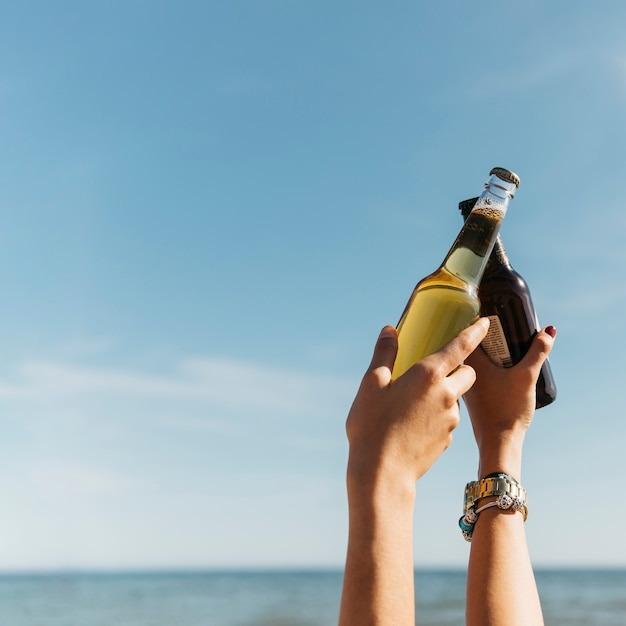 Summer concept with beer at the beach Free Photo