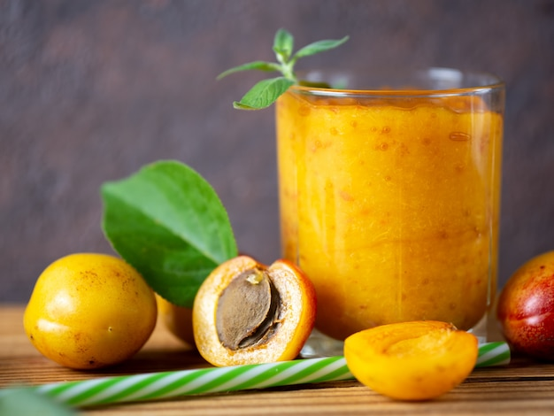 Summer delicious apricot smoothie in a glass Premium Photo