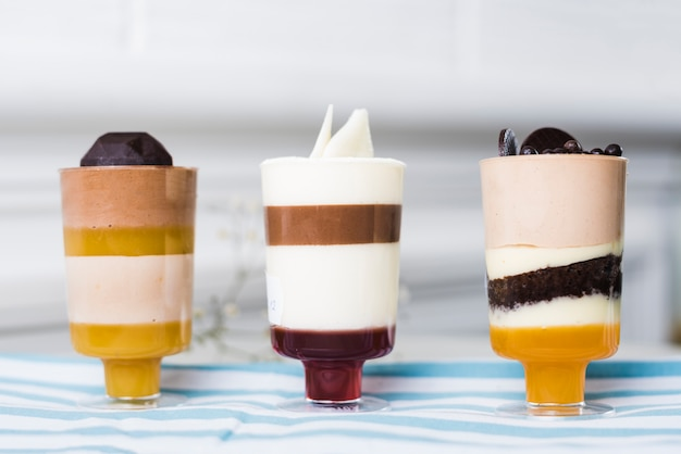 Summer desserts in glasses with chocolate toppings Free Photo