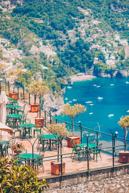 Summer empty outdoor cafe in a tourist place in italy Premium Photo