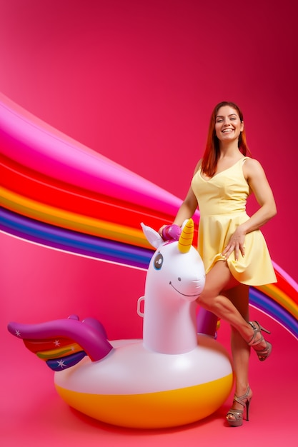 Summer fashion  beautiful woman in summer clothes having fun, smilling and posing  with balloons. Premium Photo
