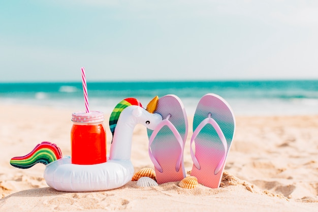 Summer flip flops with smoothies and unicorns Free Photo