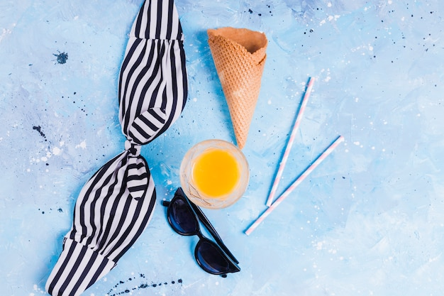 Summer food and clothes on blue background Free Photo