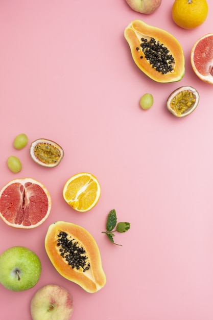 Summer food with fresh fruits frame, copy space. pink background. Premium Photo