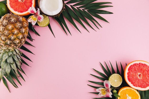 Summer fruit composition on pink table. flat lay, top view, copy space Premium Photo