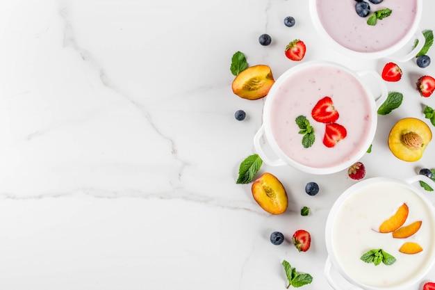 Summer healthy diet dinner, vegan food, dessert, various sweet creamy fruit & berry soups Premium Photo