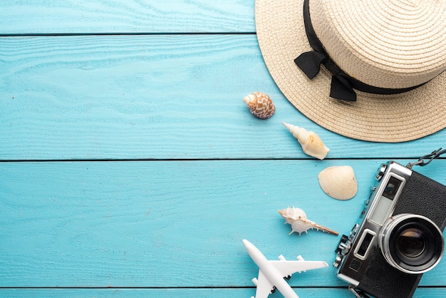 Premium Photo | Summer holiday background, travel and vacation items on  wooden table. top view