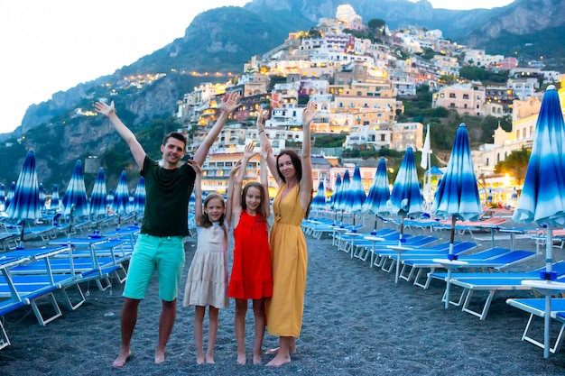 Summer holiday in italy. young woman in positano village on the background, amalfi coast, italy Premium Photo
