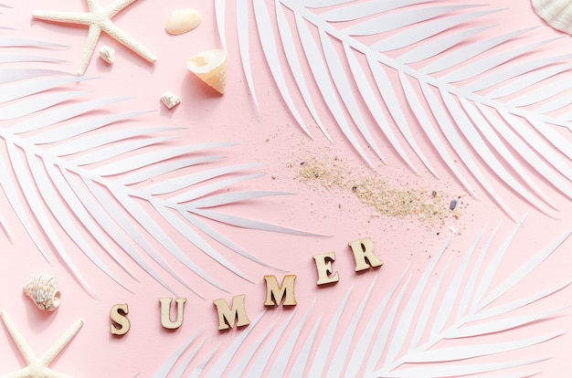 Summer inscription with palm leaves and sea stars Free Photo