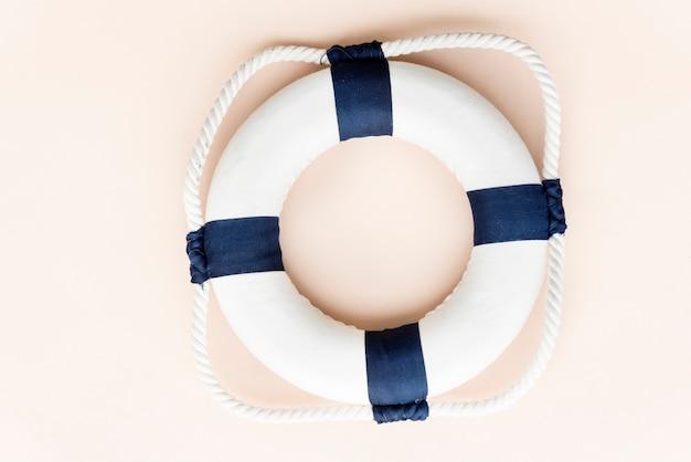 Summer lifesaving tube beach concept Free Photo