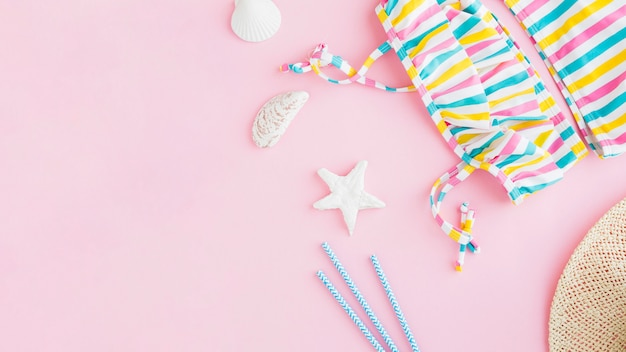 Summer marine items on pink background Free Photo
