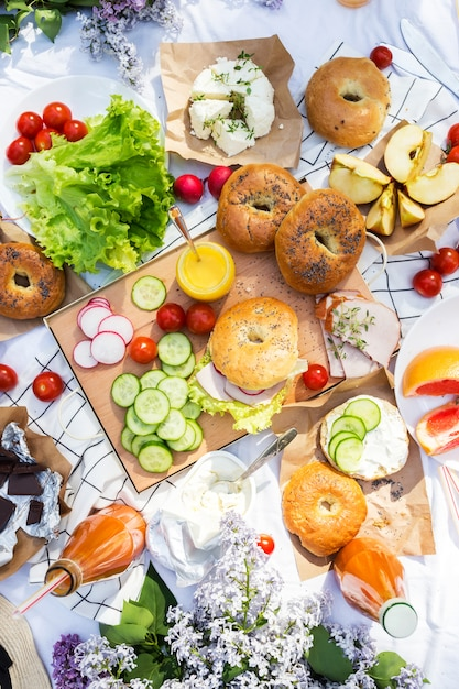 Summer picnic with bagels, vegetables and fruits.top view. healthy lifestyle Premium Photo