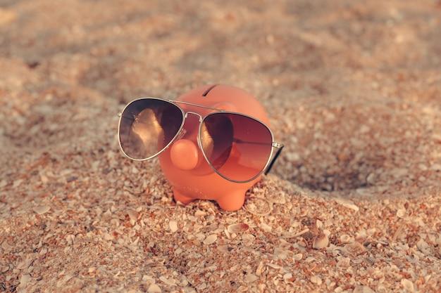 Summer piggy bank on the beach Premium Photo