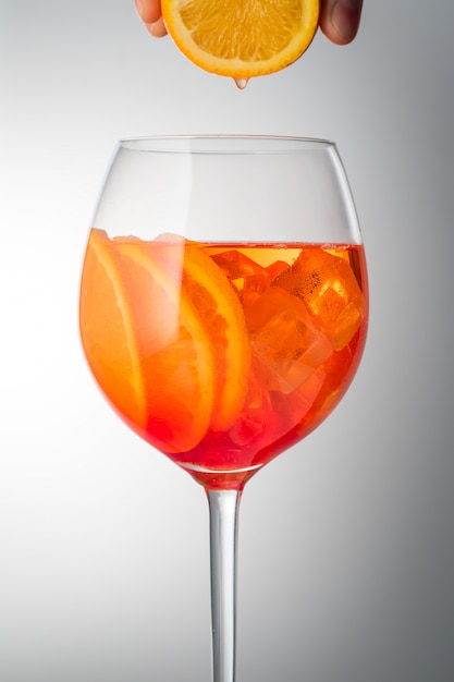 Summer refreshing faintly alcoholic cocktail aperol spritz in a glass glass with ice Premium Photo