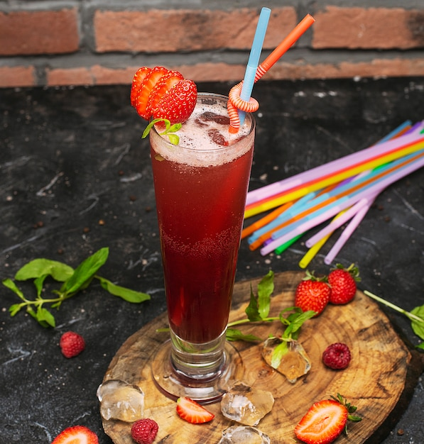 Summer refreshing healthy drink , strawberry smoothie or fresh with mint on a wooden Free Photo