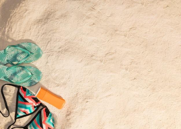 Summer resort items on sandy beach Free Photo