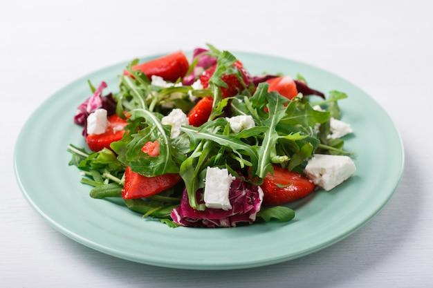 Summer salad of fresh strawberries,arugula,lettuce Premium Photo