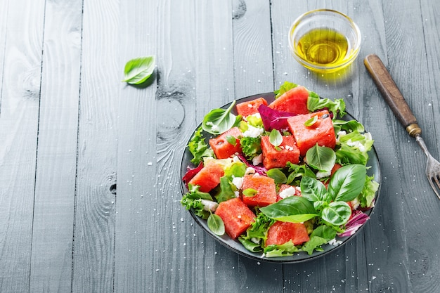 Summer salad with watermelon and salad leaves Free Photo