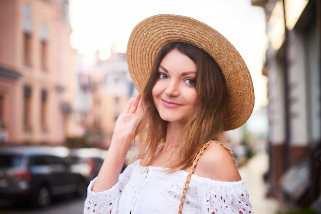 Summer smiling woman on holidays in europe walks in old center and admires the sights Premium Photo