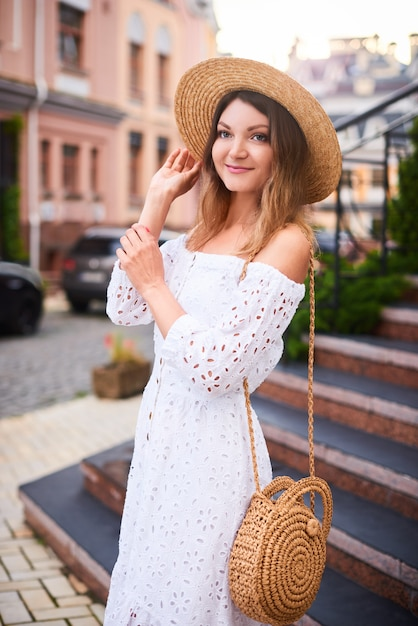 Summer smiling woman on holidays in old european city Premium Photo