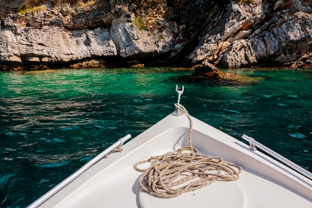 Summer time view from yacht gangway on the rocky cliff Premium Photo