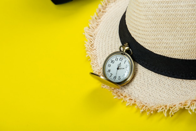 Summer travel accessories on yellow Free Photo