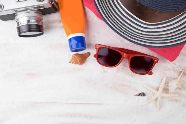 Summer travel. topview white sand beach with summer stuff. hipster style. Free Photo