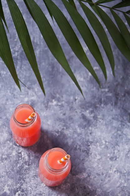 Summer tropical cocktail in a bottles Premium Photo