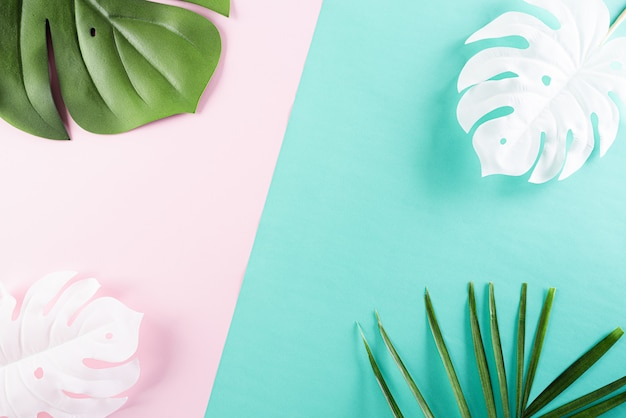 Summer tropical colorful background with palm and monstera leaves Premium Photo