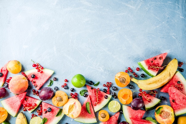 Summer vitamin food concept, various fruit and berries Premium Photo