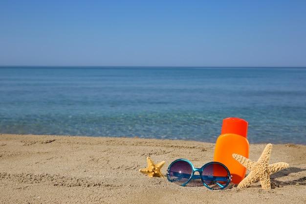 Summer women's accessories on the beach. Premium Photo