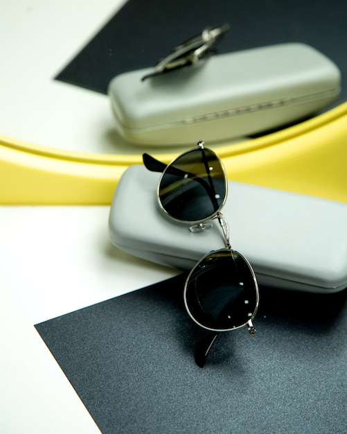 Sun glasses on the table Free Photo