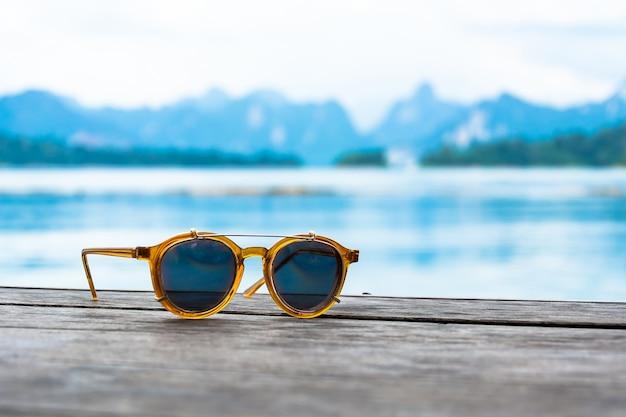 Sun glasses on wood Free Photo