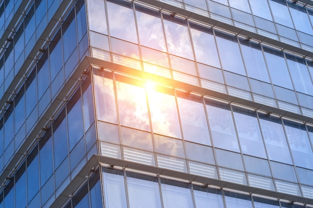 Sun reflected in windows of an office building Free Photo