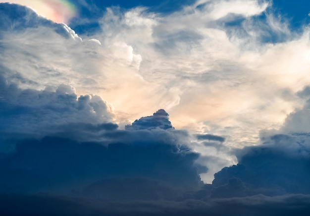 Sun shines through the rain clouds, before became rainstorm. Premium Photo