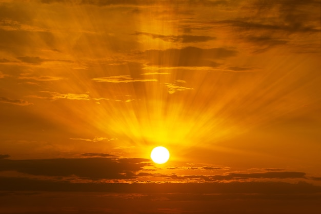 The sun shining on the sky at sunrise or sunset time background Premium Photo