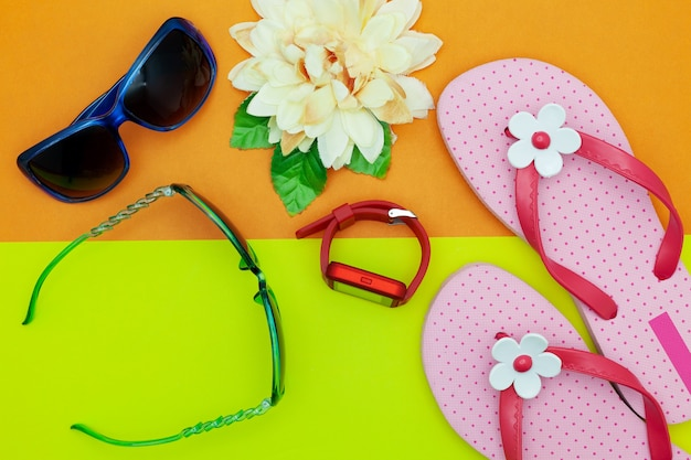 b58e5c4920be Sunglasses with beach shoes and flower on colorful paper background Premium  Photo